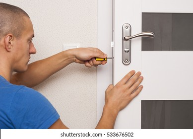 handyman repair the door lock in the room