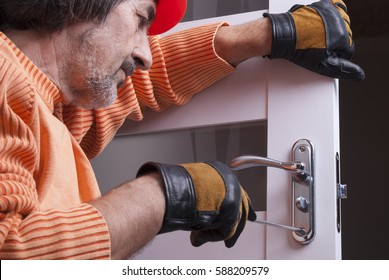 handyman repair the door lock in the room