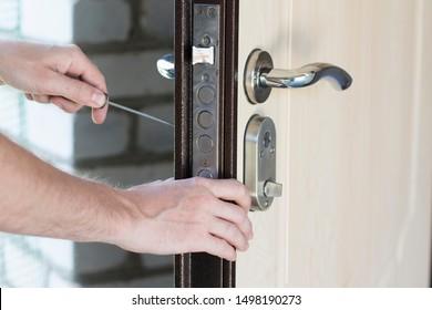 Handyman repair and installing lock in metal front door.