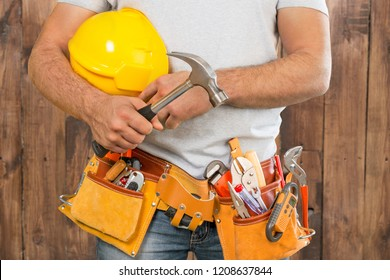 Handyman with a tool belt. House renovation