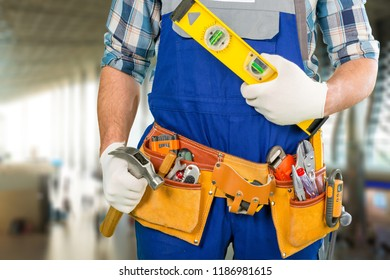 Handyman with a tool belt. Isolated