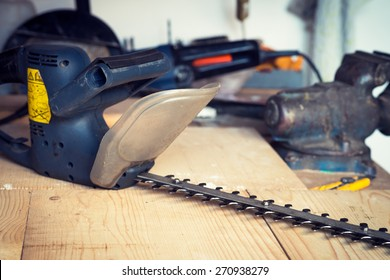 Handyman tool shed with hedge trimmer on the table