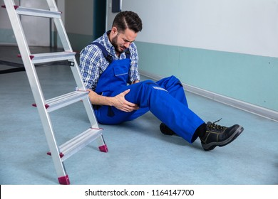 Handyman Touching His Injured Leg After Falling From Ladder