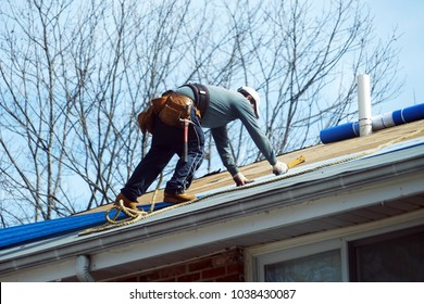 Handyman working on repairing the roof