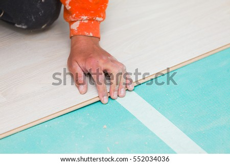 Handymans Dusty Hands Laying Down Laminate Stock Photo Edit Now