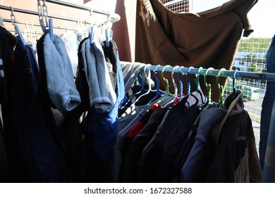 Hang clothes to dry at the back of the room