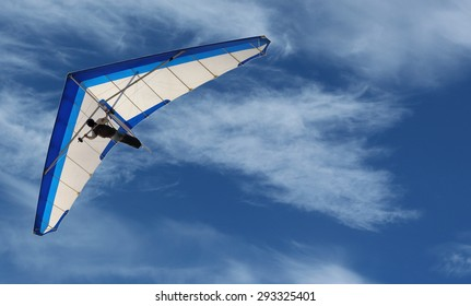 Hang Glider Hang Glider flying in the sky on a bright blue day