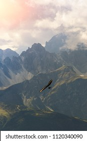 Hang glider high in the mountains. Extreme sport in the Alpine mountains