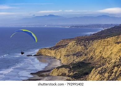 Hang glider soaring at Torrey Pines hang glider port along the coast at La Jolla California USA