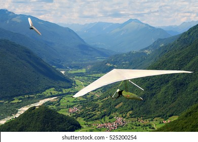 Hang gliding in Slovenia, Slovenian Open Championship 2009 (Kobala Open). Two gliders and beautiful mountains.