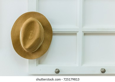 b6a3c7b7deb Hang Your Hat woven straw hat hanging on a wall rack