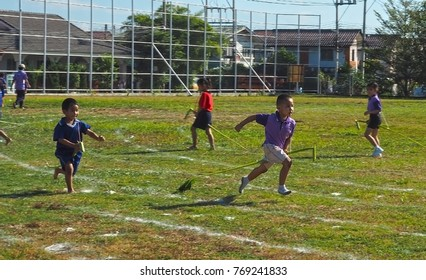 Hangdong, Chiangmai / Thailand - December 01 2017: Unidentified Thai kids show the spirit of competition at Kindergarten sports day.
