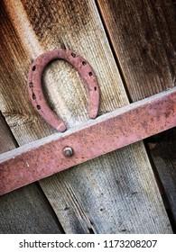 hanged horseshoe on a wooden door for good luck