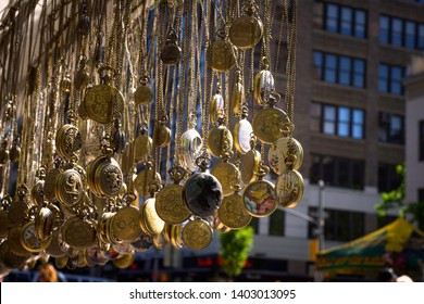 Hanged locket sell on street market in New York, USA for tourist on 18 May 2019