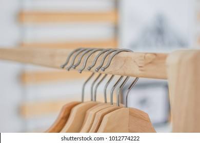 Hanger hanging on a clothes rack in the bedroom.