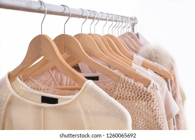A hanger with Knitted sweaters sweaters.fur jacket -gray background