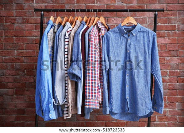 Hangers Different Male Clothes On Brick Stock Photo (Edit