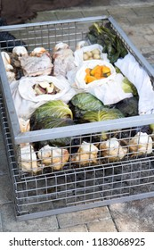 Hangi food: meat and vegetables cooked in a traditional Maori earth oven, similar to an umu, in wire basket, in New Zealand, NZ. Includes chicken, pork, cabbage, pumpkin, kumara sweet potatoes.