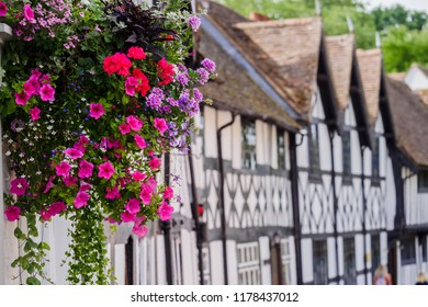 Hanging basket of flowers against background of medieval timbered houses Warwick Warwickshire England