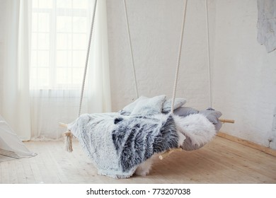 Hanging bed in white room