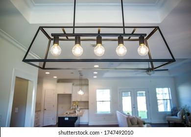 Hanging black metal iron modern chandelier lighting fixture with vintage bulbs