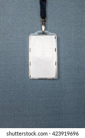 hanging blank ID card on blue fabric