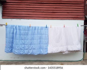 Hanging blanket outdoor for making it dry. Laundry concept.