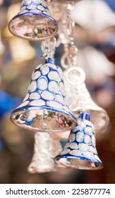 Hanging blue and silver colored jingle bells during Christmas fesival
