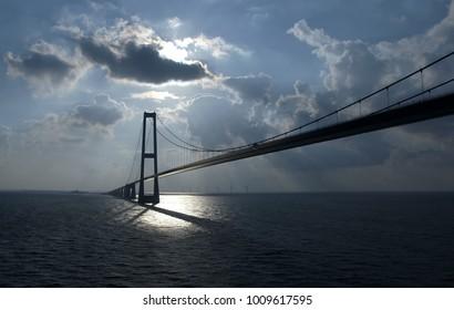 Hanging bridge Great Belt Bridge in the sea in Denmark