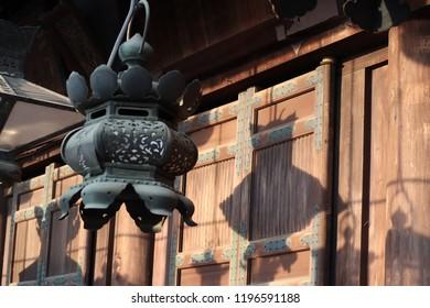 Hanging bronze lantern and shadow