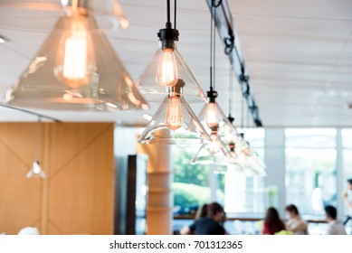 hanging ceiling lights in a modern shared office space