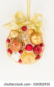 Hanging christmas ball of a collection of small golden and red pieces for decoration with golden bow