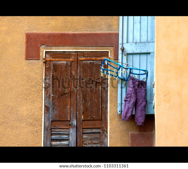 hanging clothes out to dry in an old french street