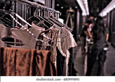 a hanging clothes rack put in the corridor in backstage of fashion show