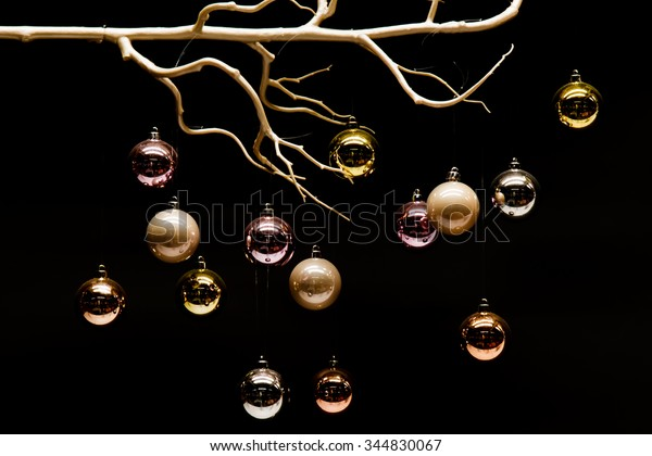 Hanging colorful Christmas balls on black background