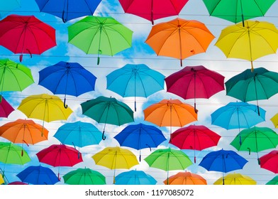 hanging colorful umbrellas on a sunny day