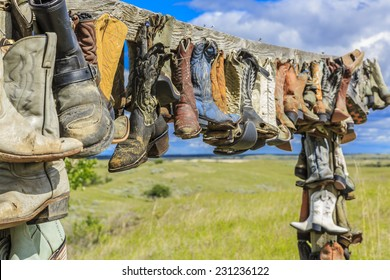 The hanging cowboy boots at the Great Sand Hills near Sceptre, Saskatchewan.  These old hanging boots are a memorial to John Booth who was a local rancher and lived in the area his entire life.