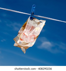 Hanging crumpled Singapore money on the rope