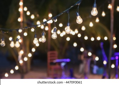 Hanging decorative lights for a wedding party