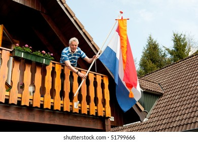 Hanging the Dutch flag for queens day
