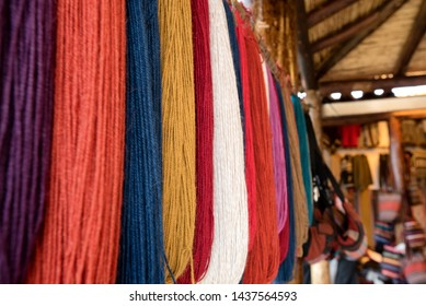 Hanging dyed alpaca yarn in multiple colors