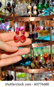 Hanging earrings on a market stall