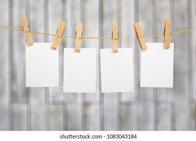 hanging empty polaroid photo frame on rod