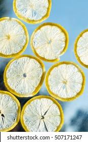 hanging, falling and flying slice of lemon on glass