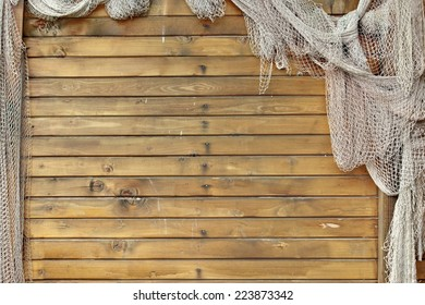 Hanging Fishnet on Wood Wall. Background and Texture for text or image.