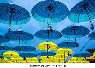 Hanging flag-coloured umbrellas show at Kyiv day. Evening time. Kyiv, Ukraine.