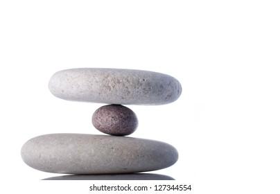 Hanging or floating rocks isolated on white inside studio.