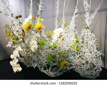 Hanging Flower arrangements on a white background.