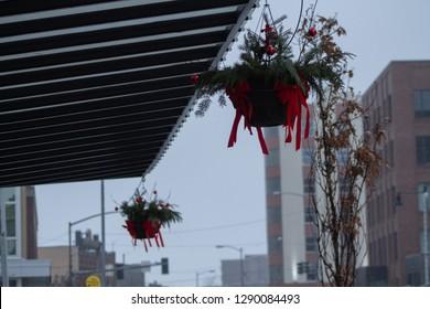 Hanging flowerpots in front of a market in downtown Missoula, MT.