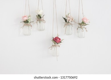 Hanging glass jars with flowers interior wall decoration